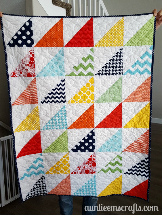 Rainbow Half Square Triangle Quilt. This rainbow HST (half square triangle) quilt came together in just one day. You, too, can make one quickly with scraps or even a layer cake.| Auntie Em's Crafts